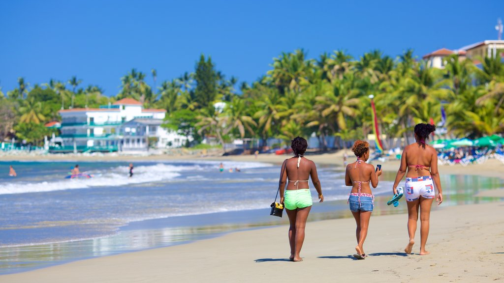 Puerto Plata showing a beach as well as a small group of people