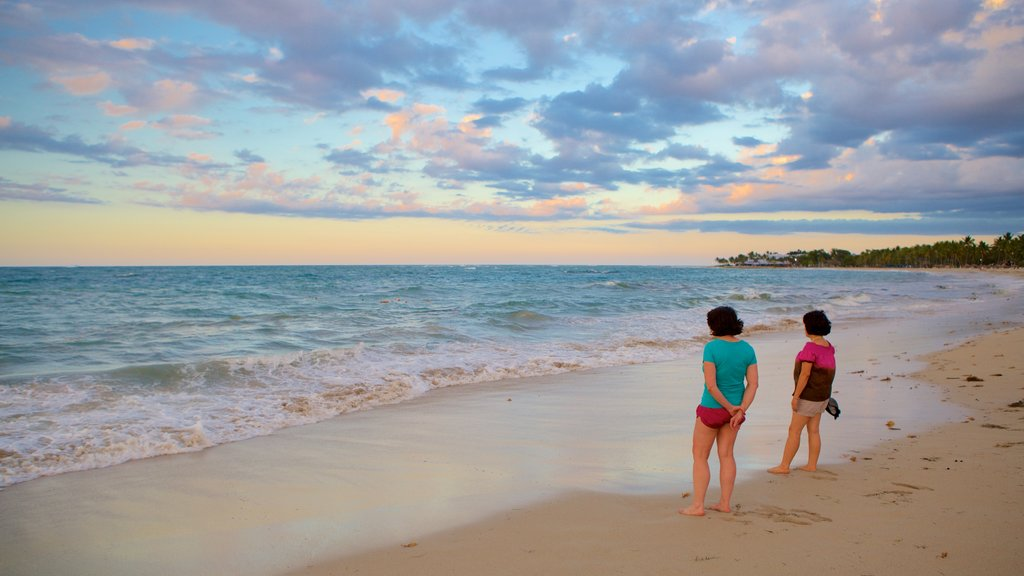 Puerto Plata featuring a beach as well as a small group of people