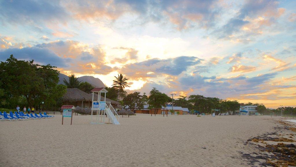 Playa Dorada which includes a sandy beach and a sunset