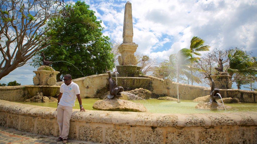Altos de Chavon Village which includes a fountain as well as an individual male