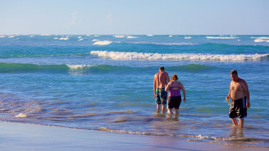Uvero Alto which includes a beach as well as a small group of people
