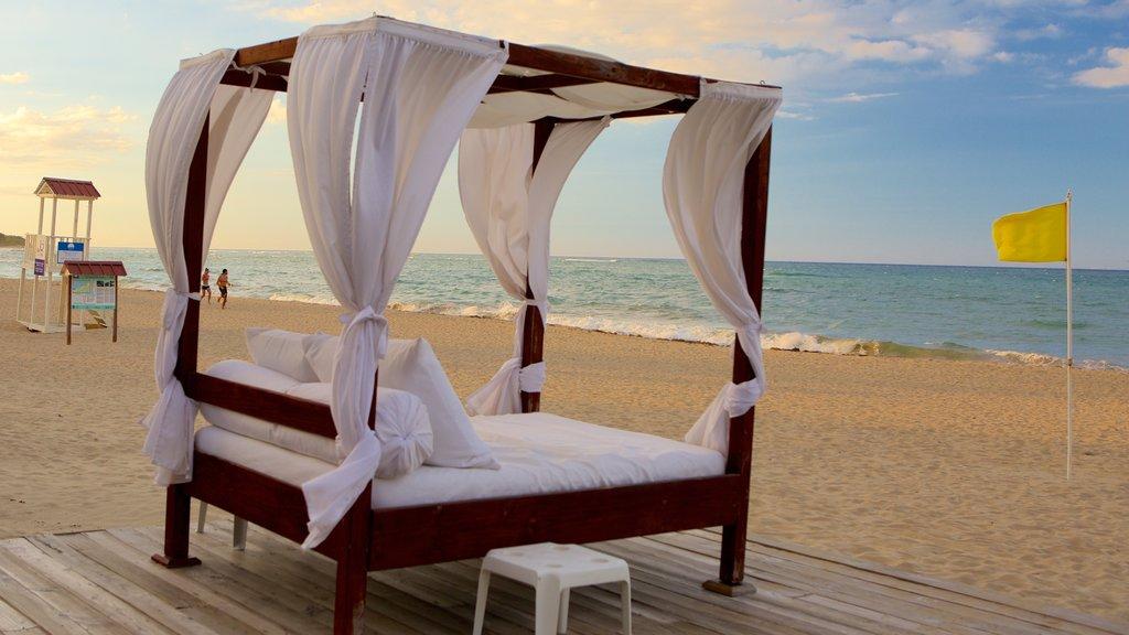 Playa Dorada featuring a sandy beach and a luxury hotel or resort