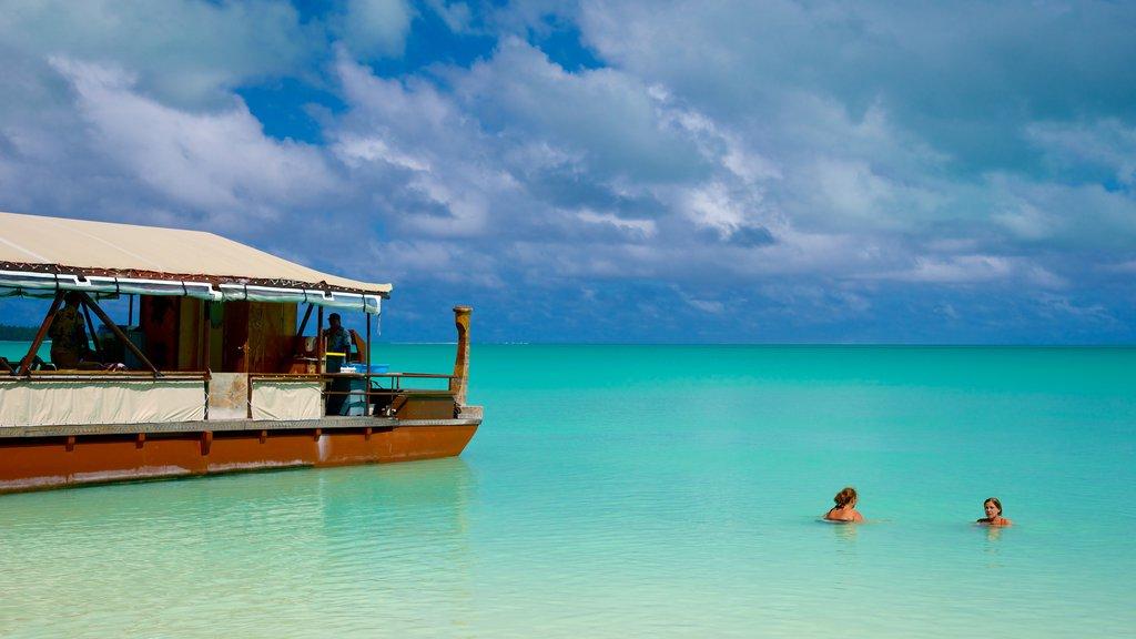 Aitutaki que incluye vistas generales de la costa y natación