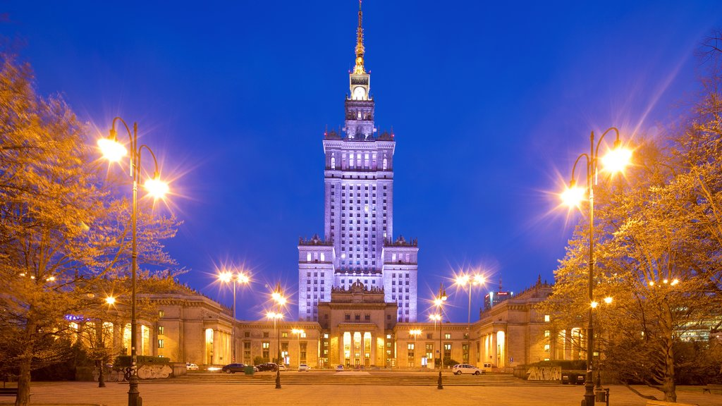 Palace of Culture and Science which includes heritage architecture and night scenes