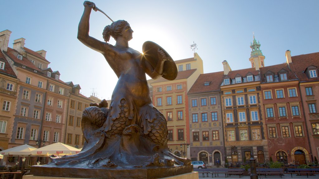 Warsaw showing a square or plaza and a statue or sculpture