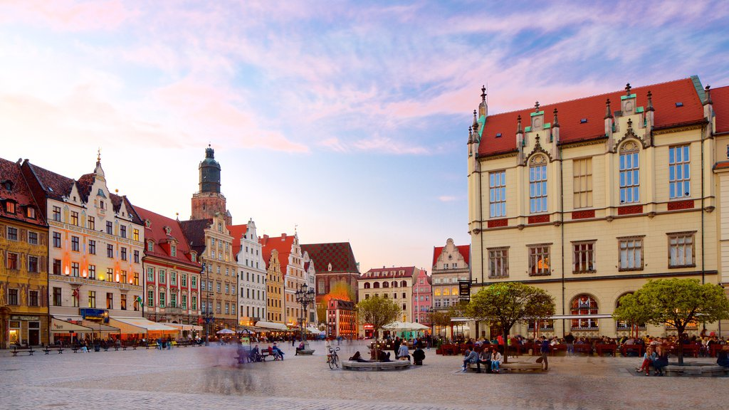 Wroclaw Market Square showing a square or plaza and a sunset