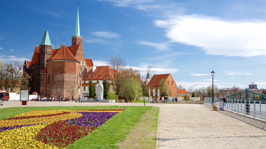 Wroclaw featuring a church or cathedral, heritage elements and flowers