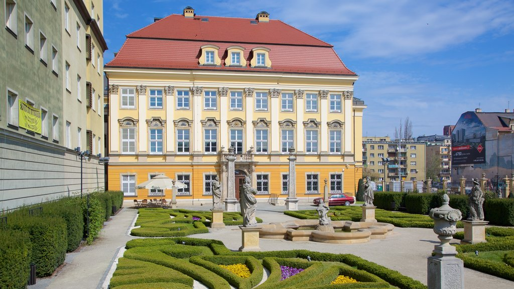 Wroclaw Palace featuring a statue or sculpture, a garden and heritage elements