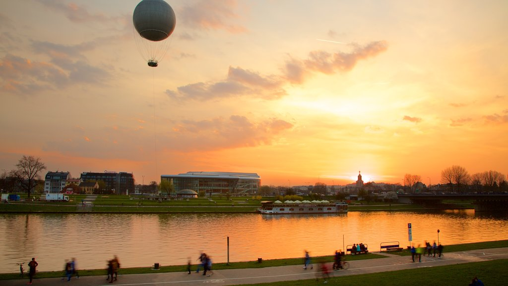 Krakow showing a lake or waterhole, ballooning and a sunset