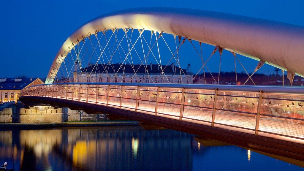 Krakow featuring a bridge and night scenes
