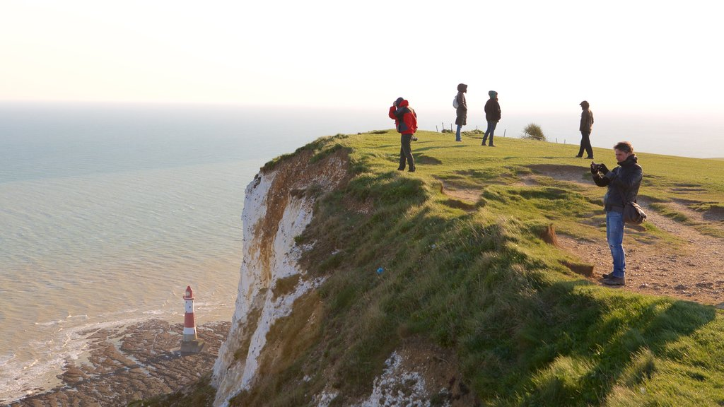 Beachy Head showing general coastal views as well as a small group of people