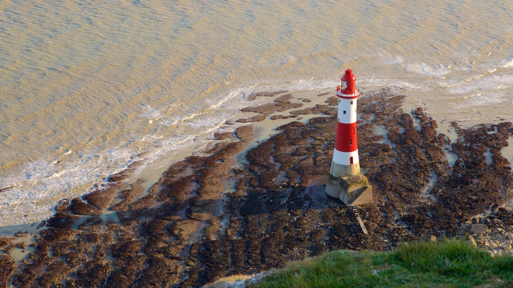 Beachy Head which includes a lighthouse and general coastal views