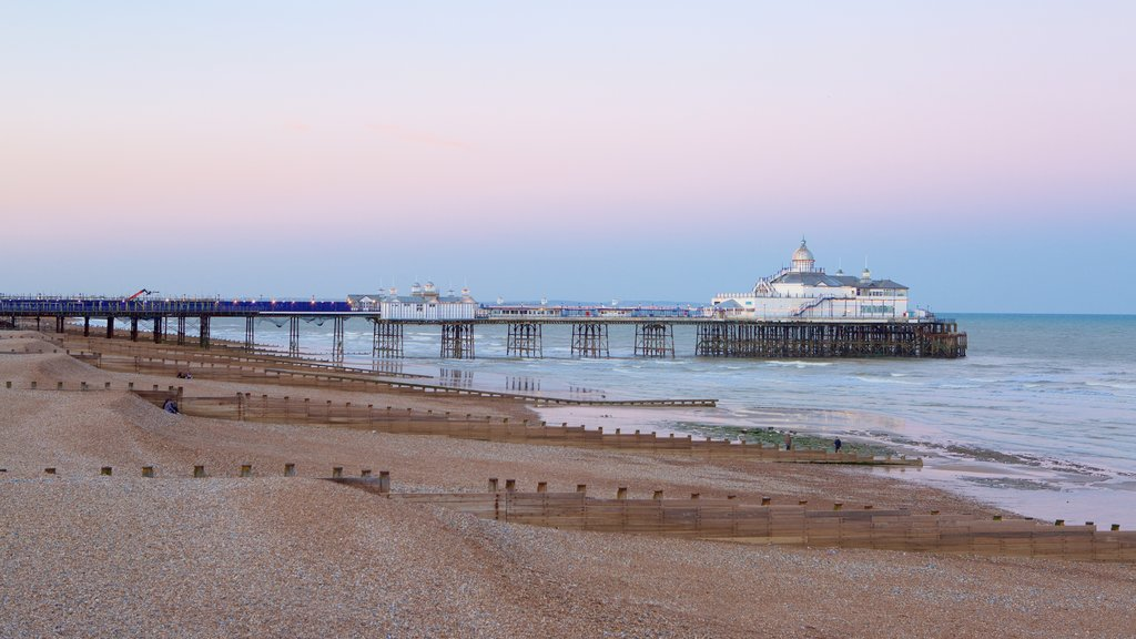 Eastbourne Pier showing a sunset and general coastal views