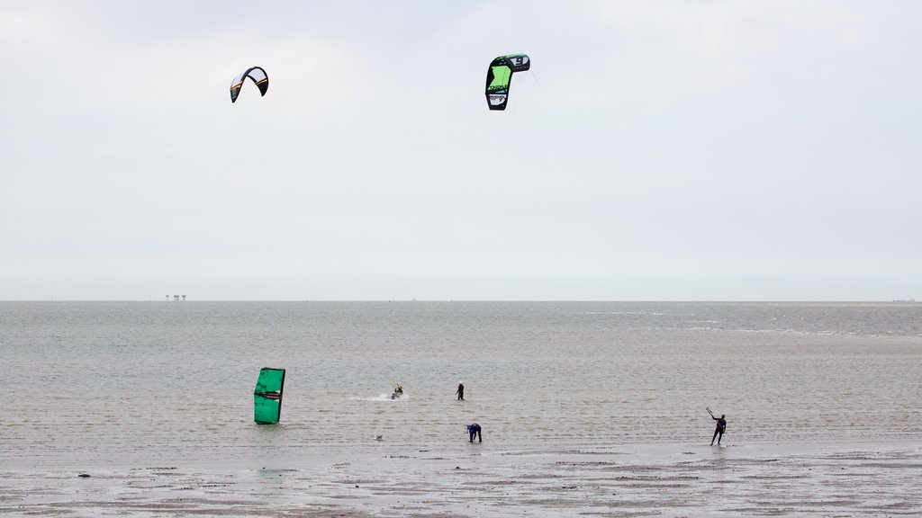 Whitstable Beach which includes kite surfing and general coastal views