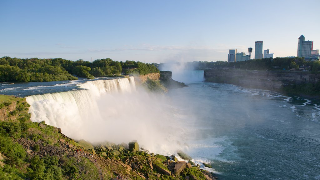 Buffalo featuring a waterfall, a city and a river or creek