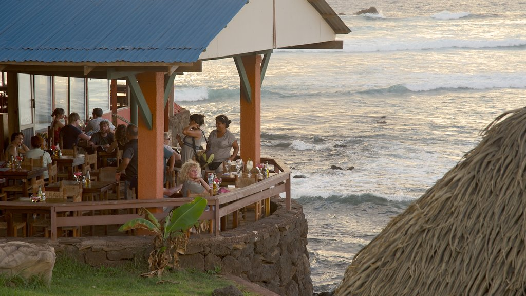 Hanga Roa which includes general coastal views and dining out as well as a small group of people