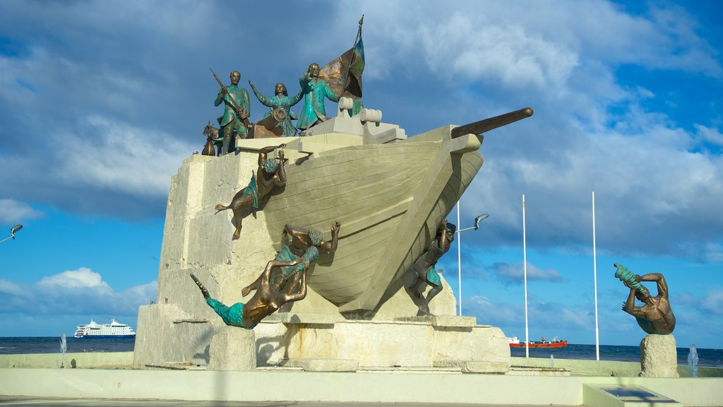 Punta Arenas featuring a statue or sculpture, general coastal views and outdoor art