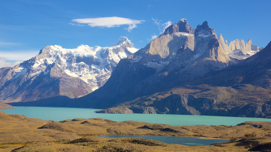 Torres del Paine National Park showing snow, a lake or waterhole and mountains