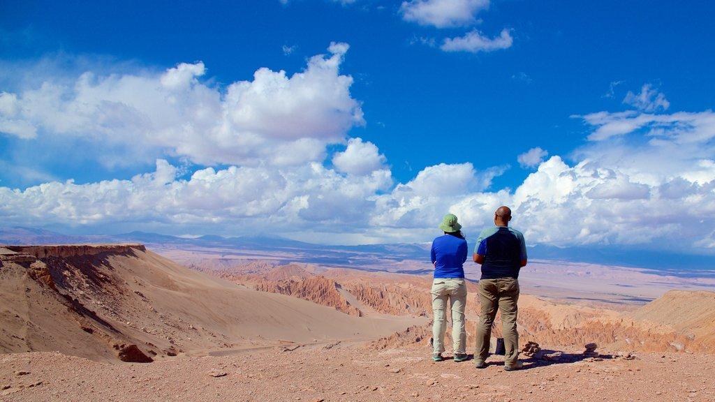 San Pedro de Atacama showing desert views and landscape views as well as a couple