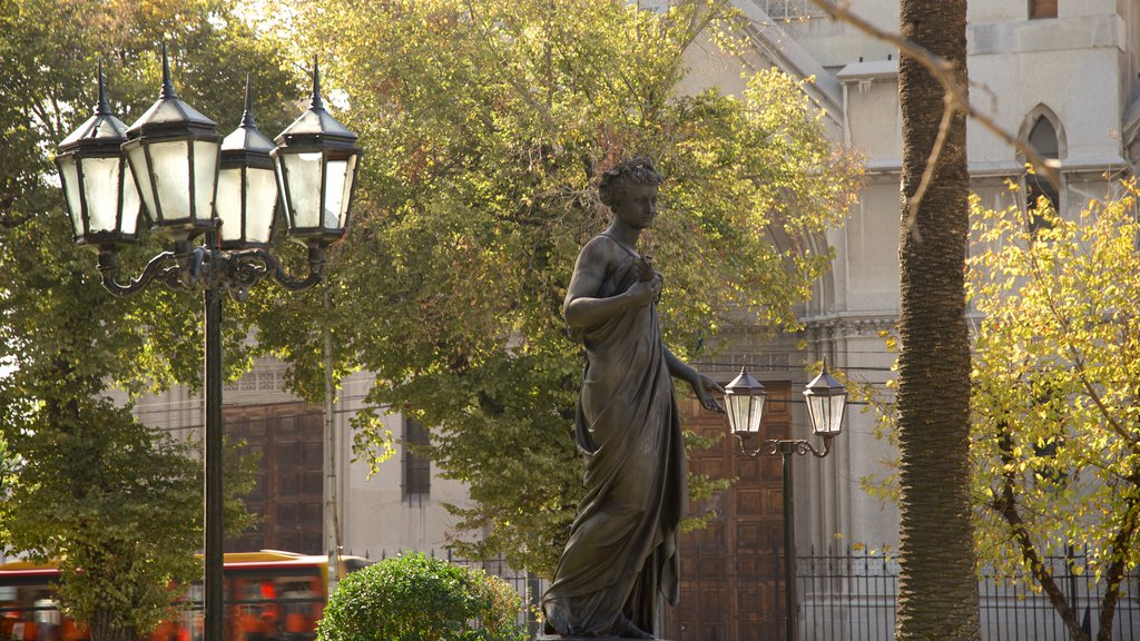 Plaza Victoria which includes a statue or sculpture