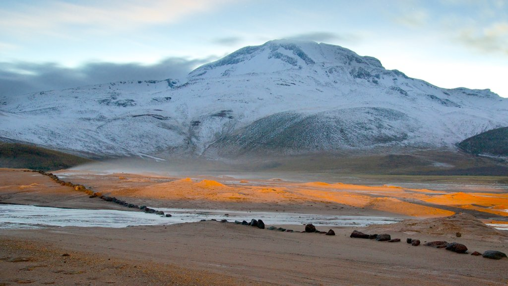El Tatio Geyser Field which includes a sunset, mountains and snow