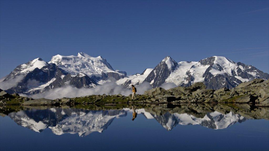 Estación de esquí Verbier ofreciendo vistas de paisajes, montañas y un lago o abrevadero