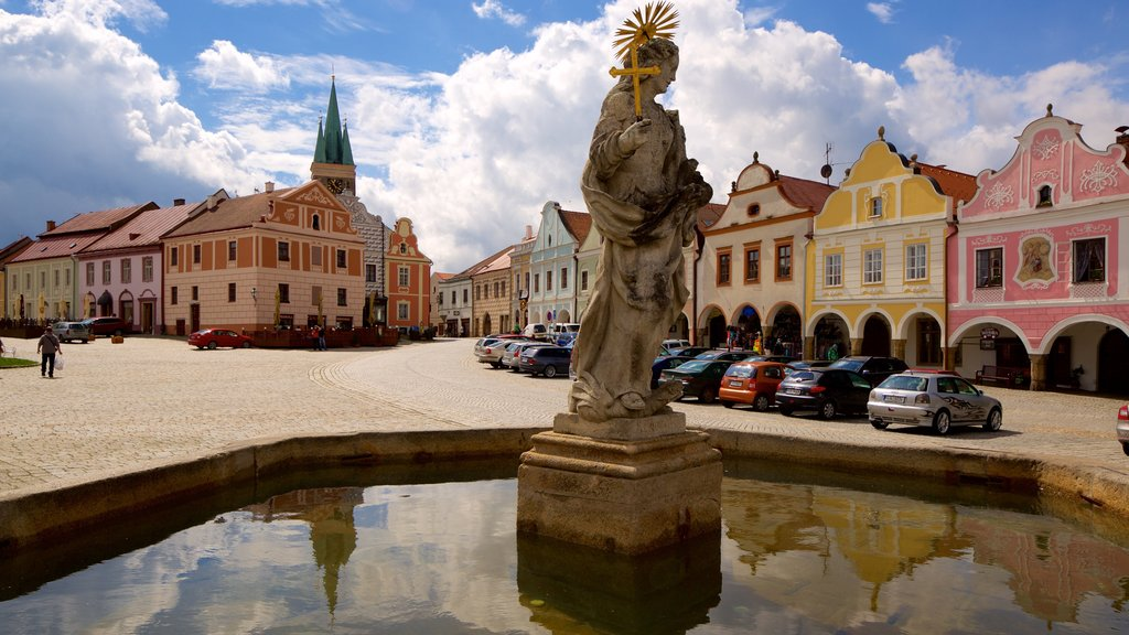 Telc featuring a fountain and a city