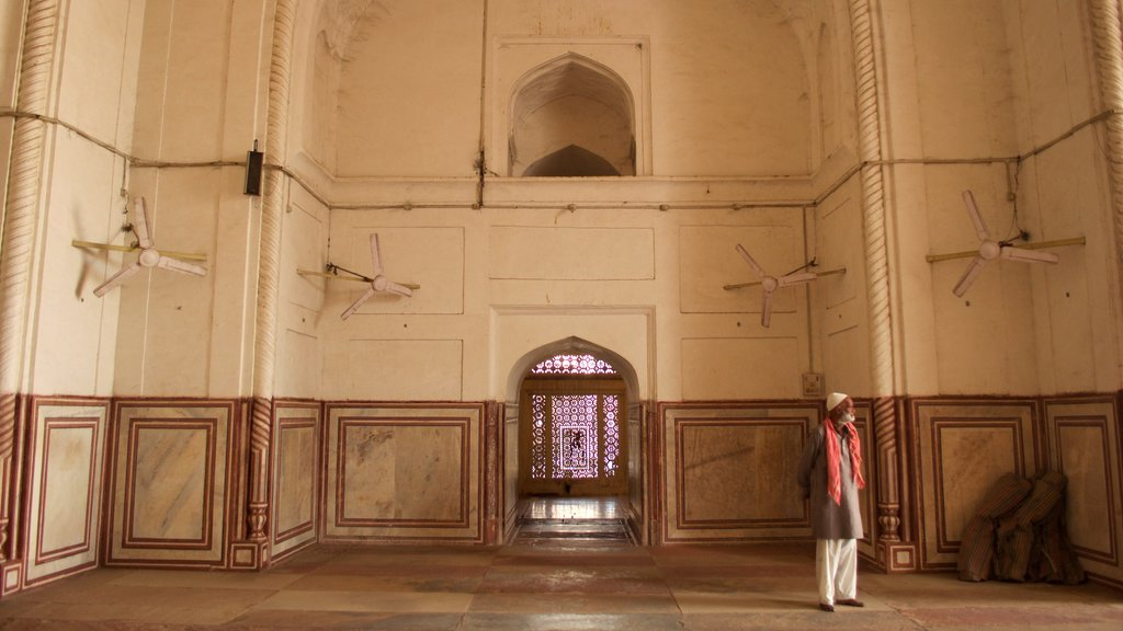Jama Masjid featuring interior views as well as an individual male