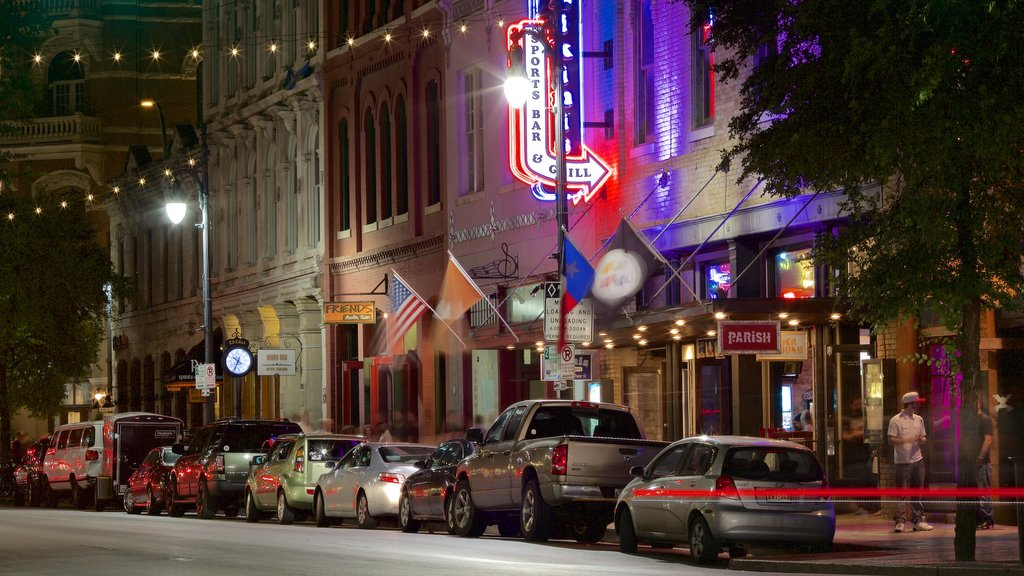 Sixth Street showing night scenes and a city
