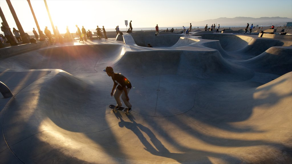 Venice Beach which includes a playground and a sunset as well as an individual male