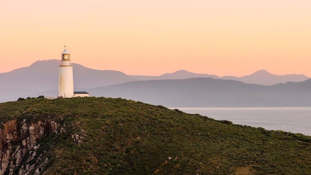 Bruny Island which includes a sunset, general coastal views and a lighthouse