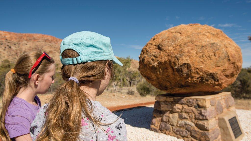 Uluru showing desert views as well as children