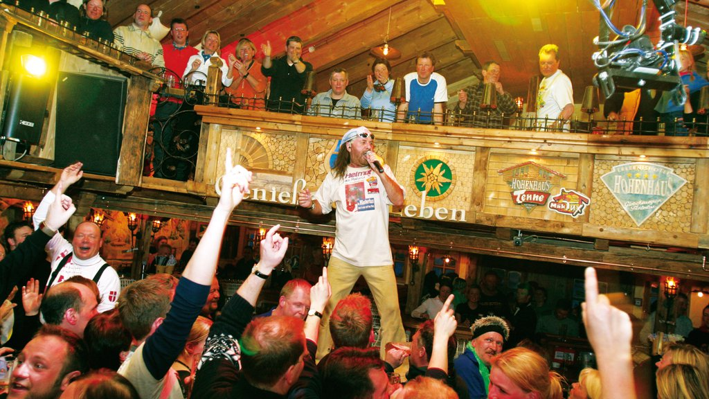 Hintertux which includes a bar, performance art and music