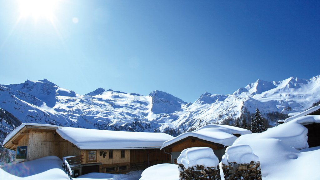 Hintertux featuring mountains, snow and a house