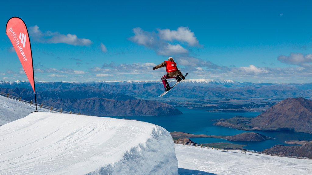 Treble Cone featuring a lake or waterhole, snow boarding and tranquil scenes