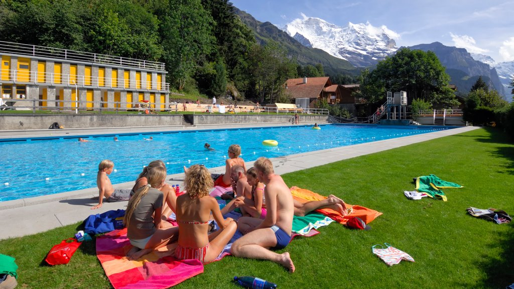 Wengen featuring a pool as well as a small group of people