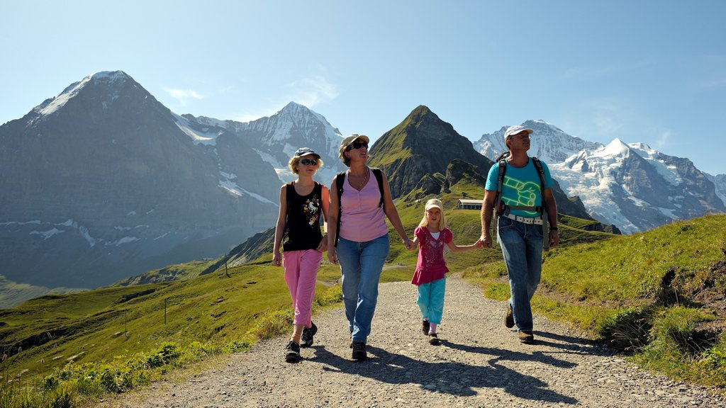 Lauterbrunnen featuring hiking or walking and tranquil scenes as well as a family