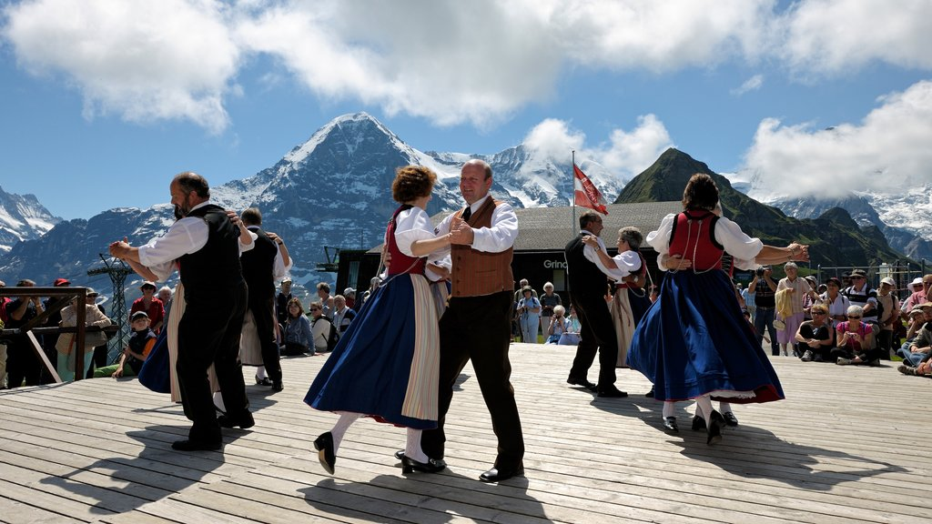 Lauterbrunnen which includes performance art and a festival as well as a large group of people