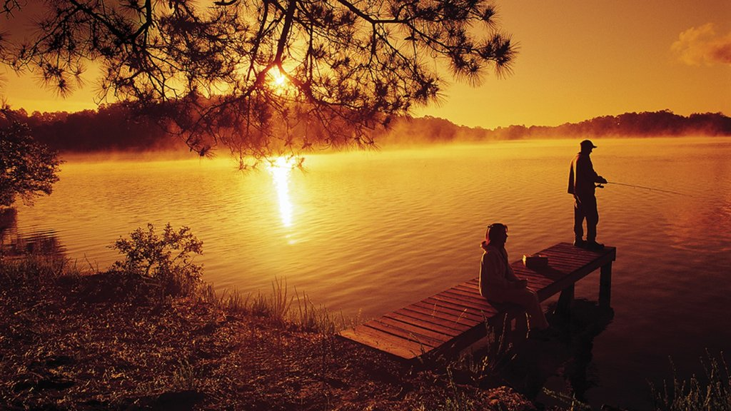 Hot Springs which includes a lake or waterhole, fishing and a sunset