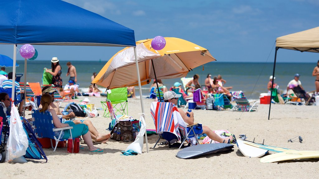 Tybee Island which includes a sandy beach as well as a large group of people