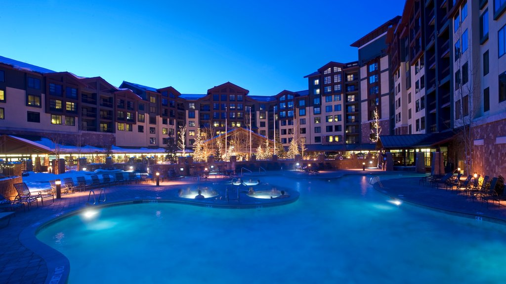 Canyons Resort which includes night scenes, a hotel and a pool