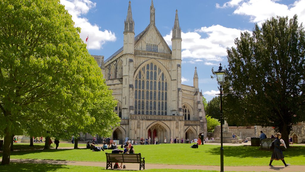 Winchester Cathedral which includes a garden, a church or cathedral and religious elements