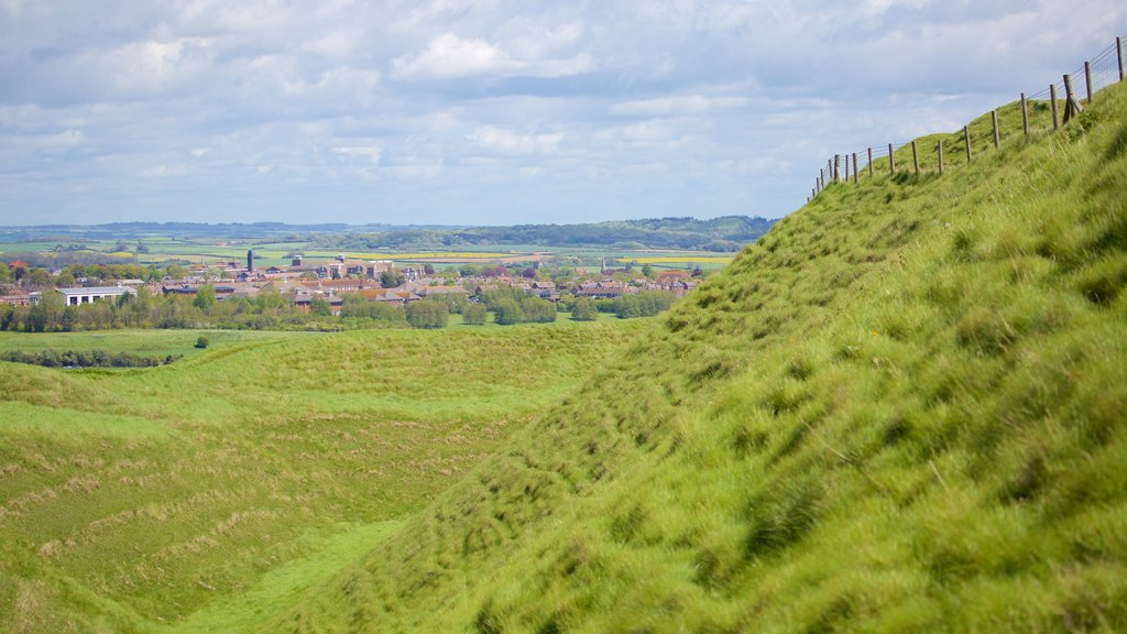Maiden Castle showing tranquil scenes and a small town or village