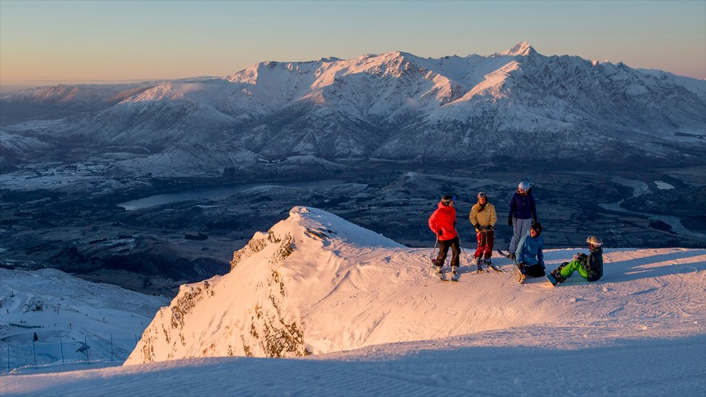 Coronet Peak Ski Area featuring snow as well as a small group of people