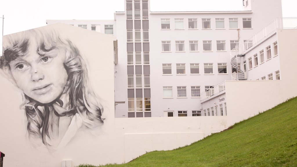Akureyri featuring a hotel and outdoor art