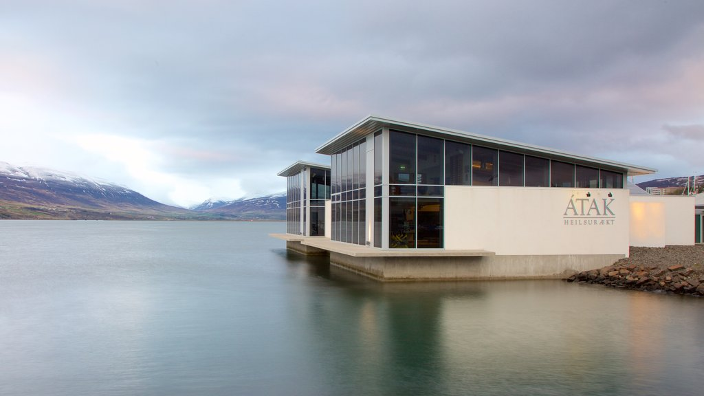Akureyri which includes modern architecture and general coastal views