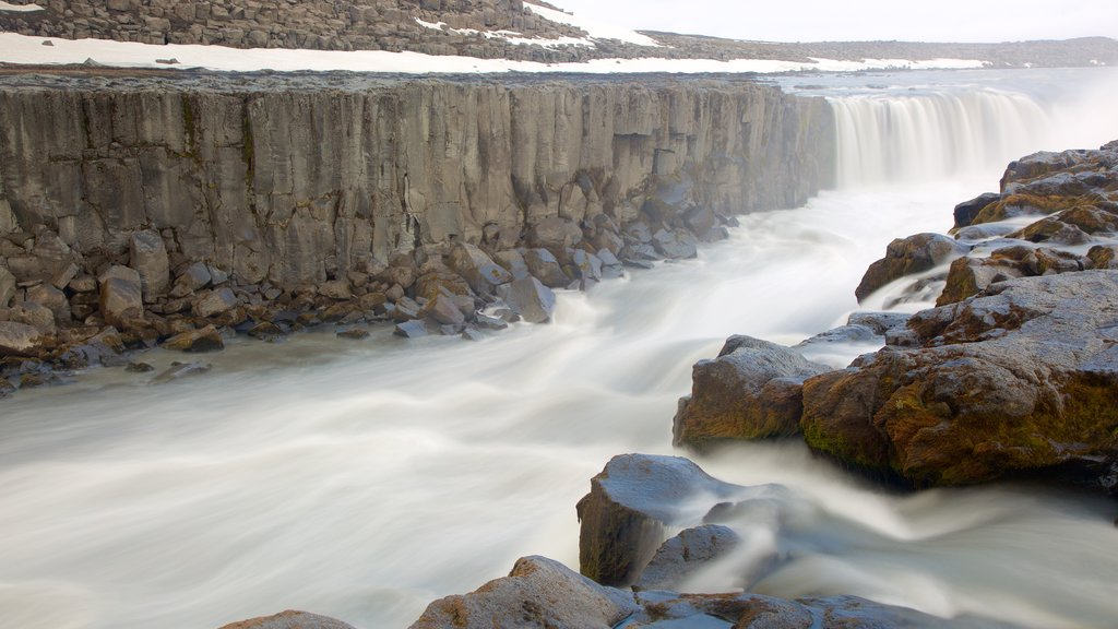 Selfoss showing rapids and a gorge or canyon