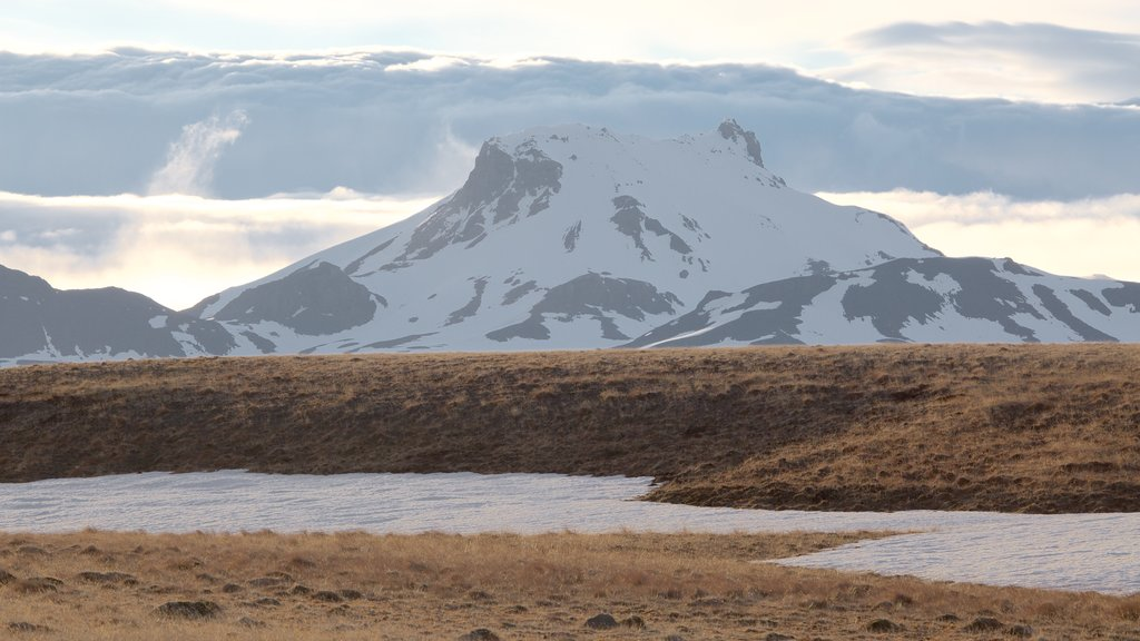 Laugarvatn which includes mountains, snow and a river or creek