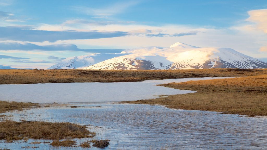Laugarvatn which includes a river or creek, tranquil scenes and mountains
