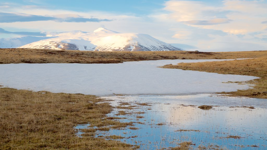 Laugarvatn showing snow, tranquil scenes and a river or creek